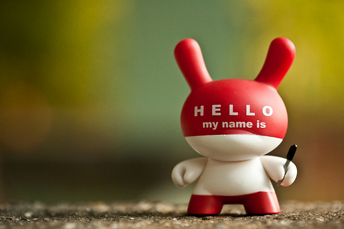 "Plastic toy with ""Hello my name is"" written on it, image by Robert Occhialini"